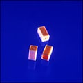 Miniature micro molded capacitor housings only 1.85 mm tall.