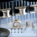 Examples of a molded coil bobbin for high-volume electronics manufacturing application.