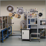 Example of Accumold's in-house automation build team for high-volume micro molding.
