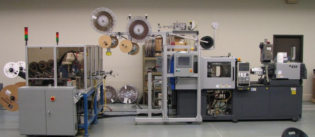 Packaging and End of Art Tooling (EOAT) system at Accumold.